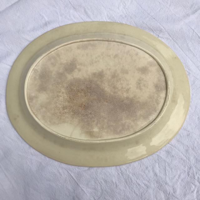 Très grand plat en terre de fer