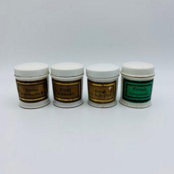 Quatre petits pots à pharmacie
