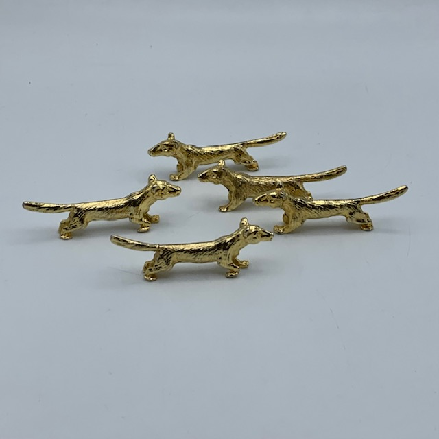 Porte couteaux chiens dorés
